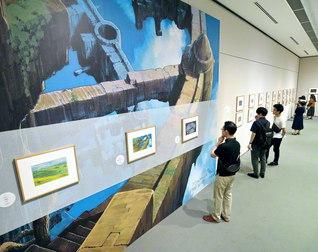 「山本二三展」では原画と共に、拡大された「天空の城ラピュタ」の背景画の複製なども紹介。ある親子は「映画のワンシーンを思い出して胸が熱くなりました」と(東京富士美術館で)